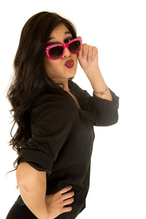 puckered lips: Sassy female wearing a black top her hand on her hip wearing pink sunglasses puckered lips kissing Stock Photo