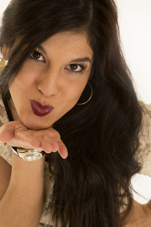 puckered: Pretty woman portrait with her lips puckered blowing a kiss