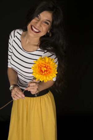 big flower: Happy beautiful female holding big flower smiling