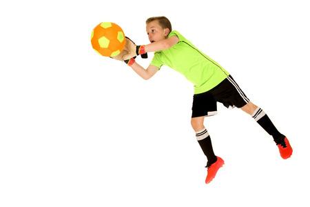 diving save: Young intense boy soccer goalie blocking shot Stock Photo