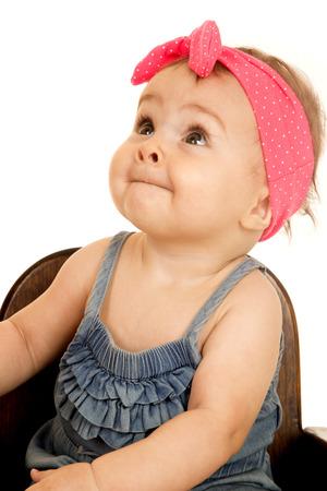 headband: Adorable baby girl looking up pink headband Stock Photo