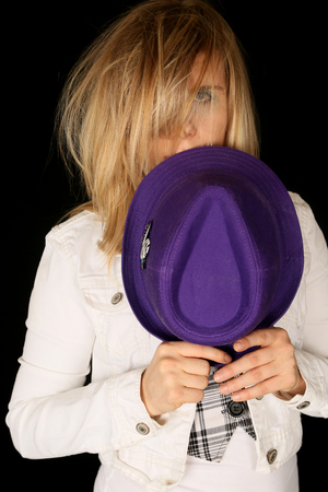 wild hair: Girl holding purple hat with wild hair