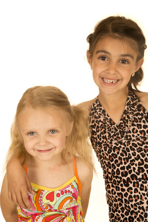 children swimsuit: Two young happy girls wearing swimsuits smiling Stock Photo