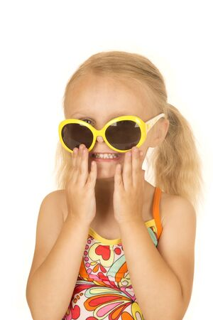 silly: Silly blond girl smiling putting on sunglasses