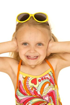 hands over ears: Blond girl wearing swimsuit hands over ears Stock Photo