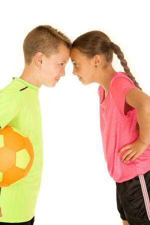 soccer uniforms: Funny portrait boy and girl soccer uniforms