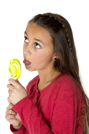 licking tongue: Cute girl sticking tongue out licking lolipop Stock Photo