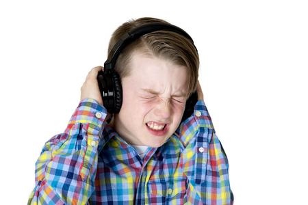 intense: preteen boy listening music headphones intense expression