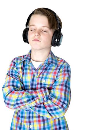 pretty preteen: Preteen boy listening music headphones peaceful expression Stock Photo