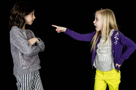 accusing: Girl pointing accusing finger at cute friend