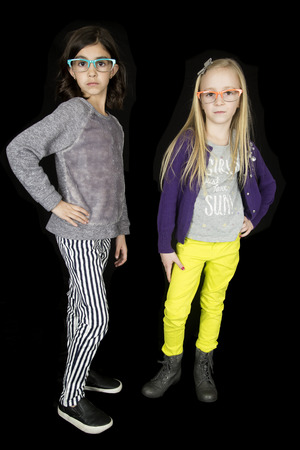 cute attitude: Two cute girls with attitude funky glasses Stock Photo