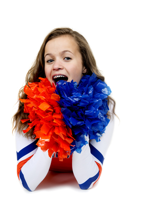 pom poms: Teenage cheerleader laying down with pom poms