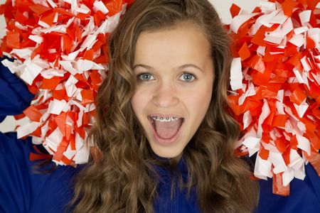 Excited cute teenage cheerleader portrait mouth open