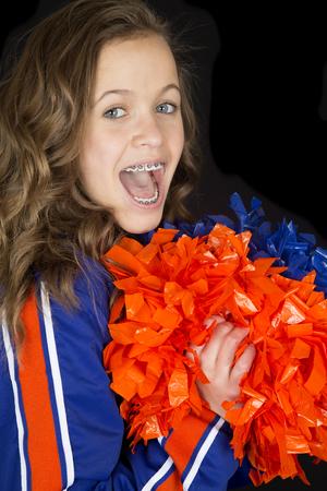 sweats: Teen cheerleader cheering excited mouth open braces Stock Photo