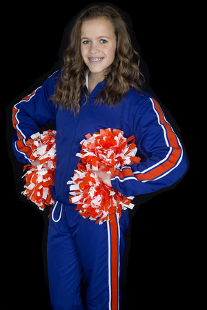 cute high school cheerleader standing blue sweatsuit