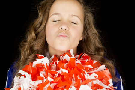 Teen cheerleader lips puckered kissing eyes closed
