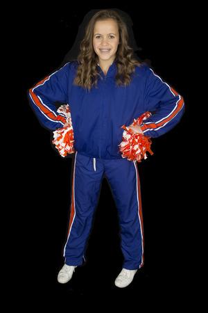 sweats: Attractive high school cheerleader with braces smiling