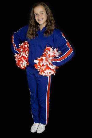 black cheerleader: Cute teen cheerleader standing smiling black background
