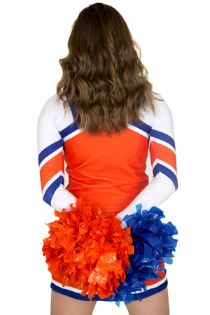 Back of teen cheerleader blue orange pom-poms
