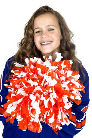 teen cheerleader with pom poms smiling braces Stock Photo