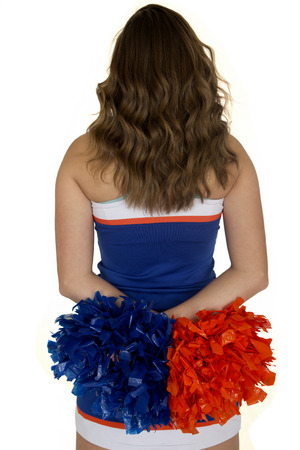 Teen cheerleader standing back view white background