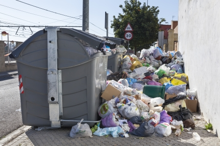 unwholesome: Seville, Spain - February 6, 2013: A strike by refuse collectors in the southern Spanish city of Seville has left vast piles of rubbish building up on the citys pavements.