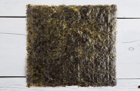 A sheet of dried seaweed on a white aged table close up Stock Photo - 21800757