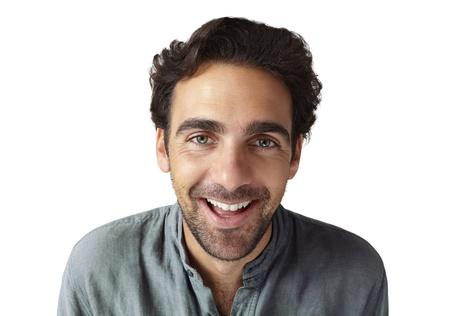 young adult man: Cheerful young adult man looking at camera