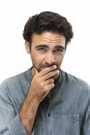 young adult man: Young adult man looking at camera flirting Stock Photo