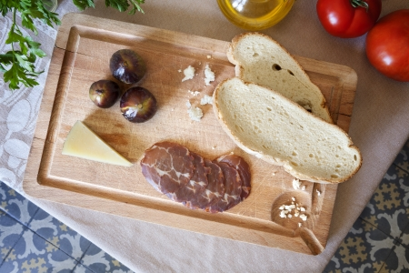 Some typical spanish appetizer on a wooden cutting board photo