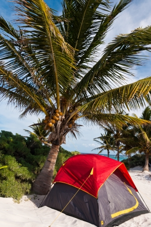 cheapest: A colorful tent that I saw on one of the Caribbean beaches in Tulum Mexico. This is probably the cheapest way of sleeping in paradise.