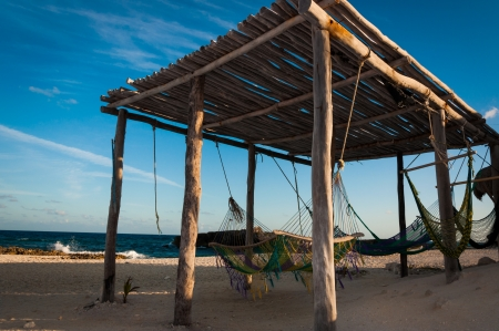 cozumel: Hammocks in a wooden hut on isla Cozumel in Mexico Yucatan peninsula. This picture was taken while driving around the island on a motorbike. Stock Photo