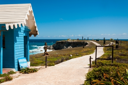 mujeres: House and panoramic view on Punta Sur Isla Mujeres Mexico Yucatan peninsula where you can see some art made of metal and a perfect view of the sea. This is the most southern point on the island and there are many iguanas here. Editorial