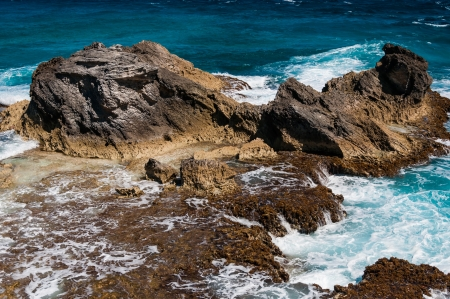 mujeres: Rocky formation on the Caribbean shore in Mexico on Isla Mujeres  Picture was taken on the southern most point of the island,  Punta Sur