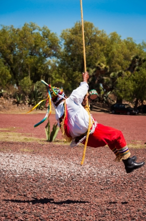Los Voladores de Papantla the flyers of Mexico Totonac indians fertility ceremony ritual dance near Teotihuacan ruins photo