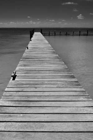 Lonely wooden pier Isla Mujeres Mexico Yucatan peninsula Caribbean black and white horizontal version Stock Photo - 13792069