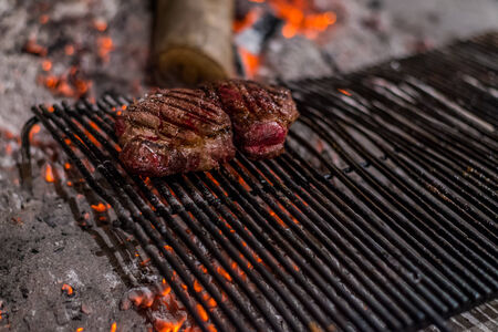 beefsteak: beefsteak on a charcoal grill Stock Photo
