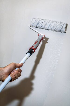 painting wall: Wall painting on white with a paint roller