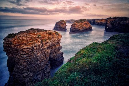 Rocks washed by the sea on the coast of Lugo
