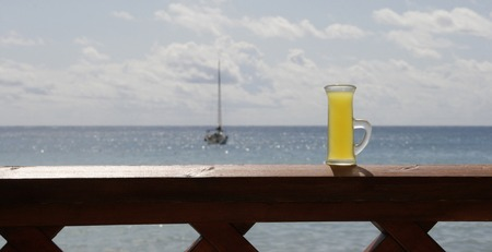 blue sea on a hot sunny day and a glass of limoncello