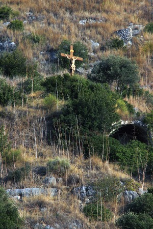 jesus statue: Jesus statue stands on the coast of Italy