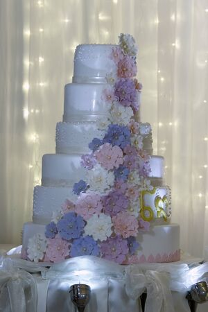Clouse up multi level white wedding cake with pink flowers stock clouse up multi level white wedding cake with pink flowers stock photo 68199642 mightylinksfo