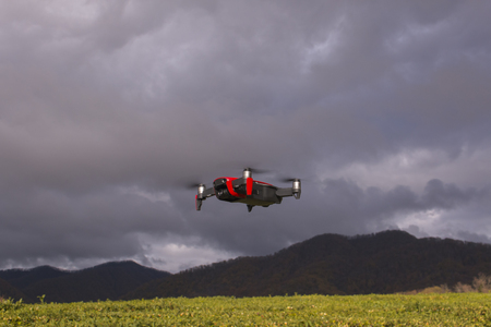 Drone portrait close-up. Flying drone under the overcast sky.