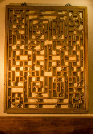 Chinese traditional wooden window lattice on the wall Фото со стока