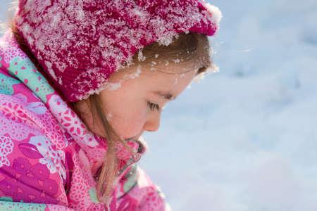 Close up Portrait of cute little girl in winter