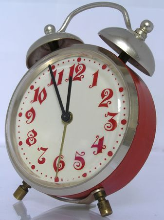 clang:  Red vintage alarm clock set to 11.55pm