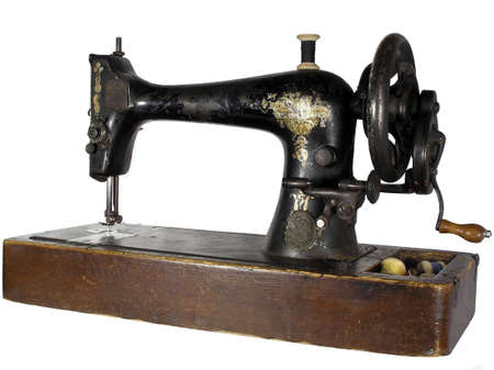 black and white sewing: Vintage Sewing machine isolated over a white background