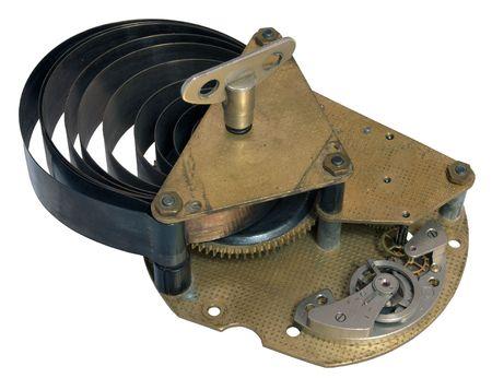 dissolved:       Parte del vecchio meccanismo orologio con una molla sciolto