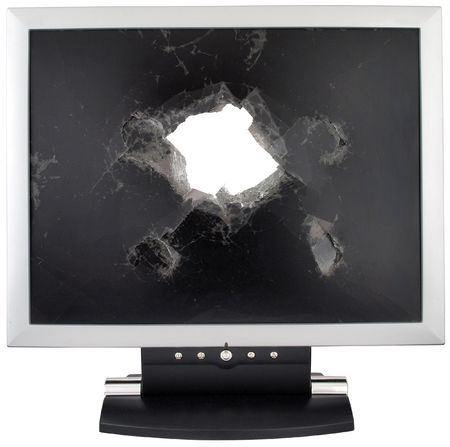 Broken monitor with a hole in the middle. photo