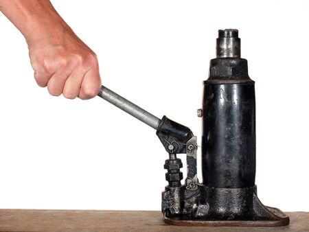 Hand using automobile hydraulic bottle jack 版權商用圖片